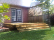 image of simple deck with wrao around stairs with flex fence screening